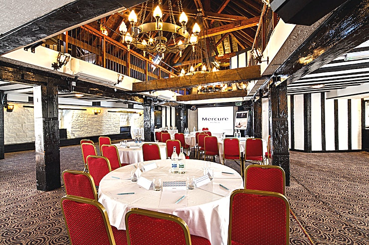 Kinnoull Suite **The Kinnouli Suite at Mercure Perth Hotel is a spectacular function room for hire in Perth.**  The Kinnoull Suite is the venue's largest function room, with original beams and features dating back to the 12th Century.   The room holds up to 120 Guests in a theatre layout and benefits from its own private bar and balcony area making it ideal for large corporate events as well as private functions.
