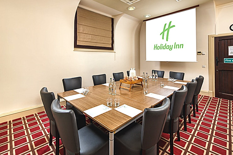 Boardroom **The Boardroom at Holiday Inn Dumfries is a stylish meeting room for hire in Dumfries.**  The Boardroom is located on the ground floor and is ideal for interviews and small meetings. The room boast