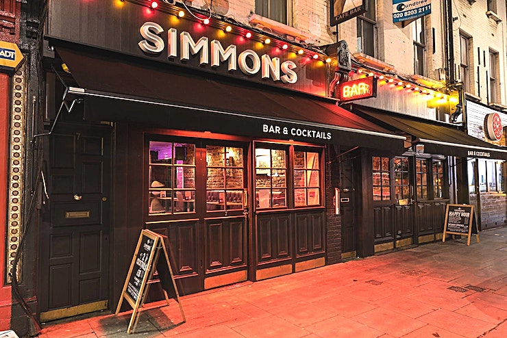 Function Room Hire **Hire the Function Room Hire at Simmons | Camden Town for your next venue to hire in London.**   Our new speakeasy-themed function room to hire in Camden has a capacity of 30 guests and is perfect for small get-togethers. With plenty of neons, decor and it's own bar, you'll love the new Simmons experience in the Camden Town 729 Basement!