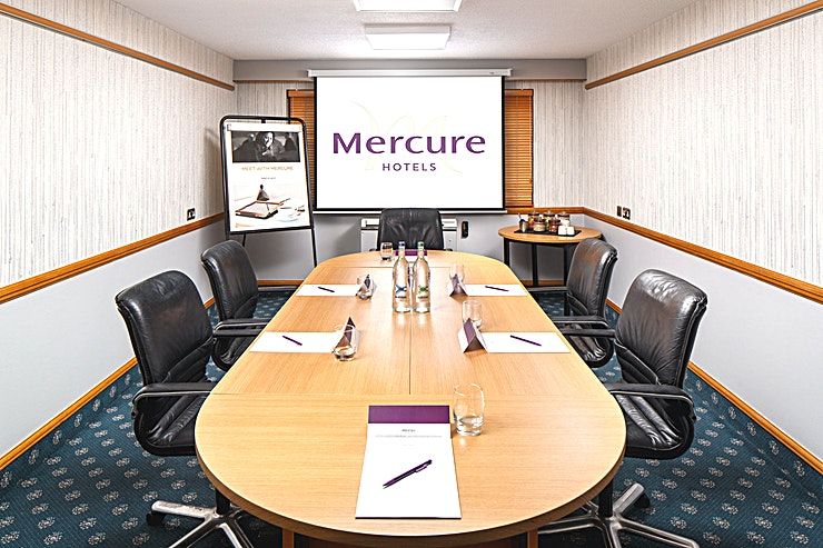 Summit Syndicate 2 **Summit Syndicate 2 at Mercure Livingston Hotel is a stylish meeting room for hire in Livingston.**  All Summit Syndicates hold up to 15 Guests in theatre layout making them ideal for interviews, s