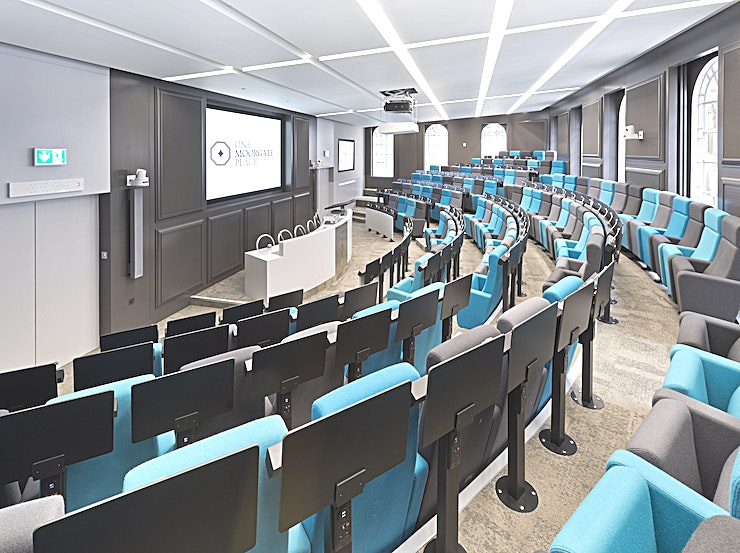 The Auditorium & Atrium  **The Auditorium at One Moorgate Place is the perfect Space for corporate presentations, screenings and conferences.**  Our Auditorium is an excellent Space to consider for a seminar, results presentation, conference or screening. Fully equipped with projectors, two screens and seating for 107, this room is perfect for discussing key topics and encourages audience participation as each seat is fitted with a desk, push to talk microphone, plug point & USB point. Plus, it has an adjoining lounge, perfect for catering, networking, canapes and drinks!