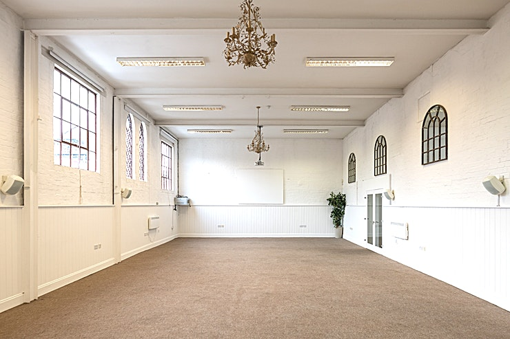 Studio 7 **A former 19th Century Unitarian Sunday School in Birmingham's Creative Quarter, boasting original windows and beautiful period features, is the perfect setting for business meetings in the Midlands.**   The venue has huge white walls and high ceilings, which compliments the natural light from the windows. It's no surprise that leading brands regularly book this stunning venue!