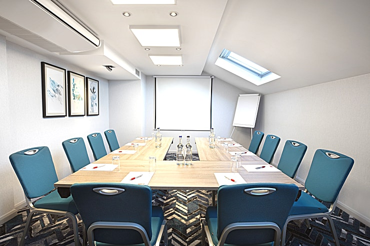 Small Suite  **Looking for your next meeting room in Heathrow Airport?**  Discover 15 air-conditioned meeting room facilities at our London Heathrow Hotel offering a range of Spaces from 2 to 130 delegates. As an added feature, we'll make sure an experienced team member is always on hand to help coordinate and set up the room to suit your exact needs.  Business guests at the Leonardo Hotel London Heathrow also benefit from complimentary, high-speed Wi-Fi and LCD projectors for presentations. You'll additionally find our stylish onsite Kitchen Bar and Restaurant that's perfect for entertaining guests before or after a meeting or event.  Located on the Bath Road, less than a 5 minute drive to London Heathrow Airport (LHR) Terminals, the hotel offers and excellent option and is ideally placed for hosting any meetings, board meetings, training sessions or corporate events.  Easy access for flight connections and tube or train into Central London via the Piccadilly Line or the Heathrow Express.