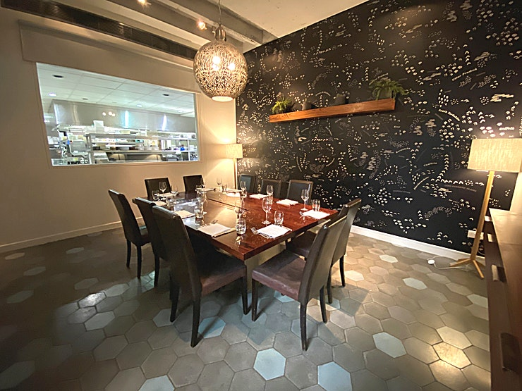 Private Dining Room **Look no further for your next Private Dining Space or Meeting Room.**  This stylish Private Dining room doubles as a chef's table, offering cinematic views of the kitchen watching the chefs prepare