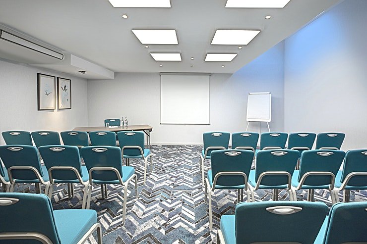 Medium Suite  **Looking for your next meeting room our by Heathrow Airport?**  Discover 15 air-conditioned meeting room facilities at our London Heathrow Hotel offering a range of Spaces from 2 to 130 delegates. As an added feature, we'll make sure an experienced team member is always on hand to help coordinate and set up the room to suit your exact needs.  Business guests at the Leonardo Hotel London Heathrow also benefit from complimentary, high-speed Wi-Fi and LCD projectors for presentations. You'll additionally find our stylish onsite Kitchen Bar and Restaurant that's perfect for entertaining guests before or after a meeting or event.  Located on the Bath Road, less than a 5-minute drive to London Heathrow Airport (LHR) Terminals, the hotel offers an excellent option and is ideally placed for hosting any meetings, board meetings, training sessions or corporate events.  Easy access for flight connections and tube or train into Central London via the Piccadilly Line or the Heathrow Express.