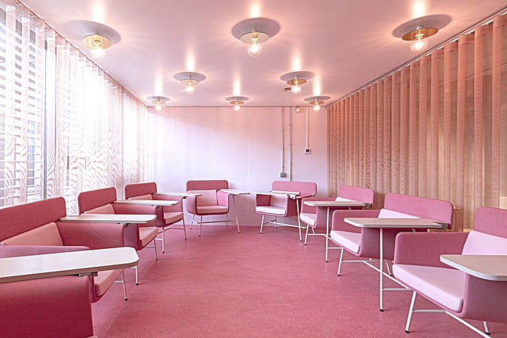 The Pink Salon **The Pink Salon is the visually perfect Space you've been dreaming of.**  No black and white thinking in The Pink Salon. Ineke Hans, one of the Netherlands' most successful designers, created this beautiful Space in one of Amsterdam's most trendy coworking venues.  From board meetings to networking, and from panel events to product launches, this Space packs a punch.  There are 10 Roald chairs, inspired on the chair on which Roald Dahl wrote his children's books. Roald chairs are a chair and a desk in one.  The pink doors of the salon are always open.