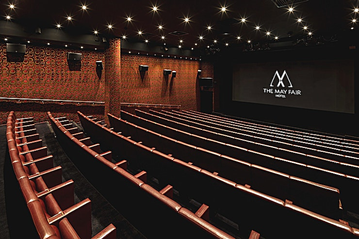 The May Fair Theatre **Need a theatre to hire for your next screening, workshop or conference? Welcome to The May Fair Theatre at The May Fair Hotel.**  The May Fair's luxury screening is the envy of many private cinemas in London.   Audiences of up to 201 guests sit in supreme comfort on Italian - leather-trimmed seats complete with armrests and fold out tables, with ample leg room to stretch out.   In front of the 8m screen a stage, available with optional speaker's podium, provides an energising and inspiring platform for multimedia presentations and filming location in London.