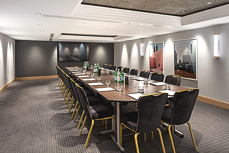 Private Room 18 **Hire Private Room 18 for your next meeting or private dinner, right in the heart of Manchester**  Private Room 18 is ideal for various type of functions, from meetings and conferences, to training courses and private dining.   With its classy decor and rich wooden accents, this beautifully decorated meeting room can host a stylish boardroom for up to 24 delegates. The venue provides a well-structured Space for events from training days to presentation-style conferences.   Private Room 18 allows for a quiet meeting venue, complete with wheelchair access, as well as parking nearby. The convenience of this Space enables Guests to have successful meetings and conferences, alongside private dining in a stylish, sophisticated setting.  Comfortable chairs and modern artwork tie the Space together for a classic meeting room venue right in the heart of Manchester's city centre.