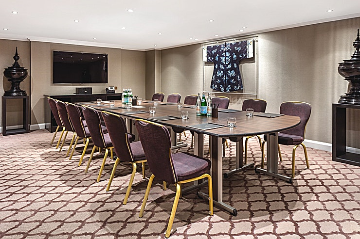 Private Suite 5 **Hire Private Room 5 at The May Fair Hotel for your next meeting room to hire in London!**   Private Suite 5 is individually designed in a signature colour to make the most of the contemporary design. The room can host a stylish boardroom for up to 16 delegates.  The May Fair Hotel is set in the heart of one of the most sought-after addresses in the world. The May Fair enjoys some of the largest bedrooms in London, including an iconic collection of suites, world-class food and drink in Mediterranean-inspired restaurant, May Fair Kitchen, a vibrant bar, secluded terrace, stunning event spaces and tranquil spa. Perfectly located close to Buckingham Palace, Bond Street's exclusive boutiques and Berkeley Street's famous restaurants, the hotel is moments from Green Park tube station, providing easy access to Canary Wharf.