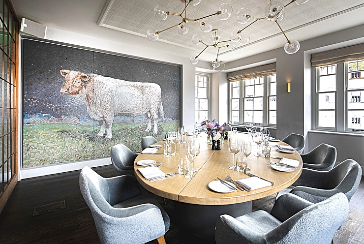 The Bull Room **Splendidly stylish, The Bull Room presents a restaurant Space to be envied**  A beautiful mosaic bull by artist Dido Crosby is a feature on one wall, creating a talking point to begin your event, and eccentric decor to accompany it.  This dining Space can accommodate up to 16 Guests in a bright and atmospheric setting.   Take in the buzz of the restaurant, while enjoying the privacy of the elegant screens that separate the Space. If you're looking for a semi-private Space to entertain your Guests, there's no better option than The Bull Room at Swan at Shakespeare's Globe.  With views of the river and the Globe Theatre, not to forget the aforementioned bull, there is plenty of great atmosphere to go round.  For an iconic backdrop for every dinner, The Bull Room at Swan at Shakespeare's Globe is an impeccable choice.