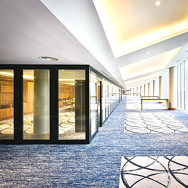 Riverview Suites  **The Riverview Suite is aptly named due to it's floor to ceiling windows with views along the Thames.**  Located on the second floor of the hotel and attached with direct access to the Arora Ballroom, the Riverview Suites boast spectacular floor to ceiling views along the River Thames.  The Riverview Suites can host up to 400 theatre style and can be split into nine individual meeting rooms which can be used for dining, breakout Spaces or additional meetings.   Surrounded by historic landmarks, InterContinental London – The O2 is a luxury hotel and purpose-built conference centre featuring the UK's largest pillar-free ballroom of 3,013sqm with a 7.2m ceiling height, accommodating for over 3,000 delegates. The hotel also features 19 additional versatile meeting Spaces, a full-service luxury spa and five restaurants and bars inspired by the destination's rich history.  The 3 AA Rosette and Michelin Guide, Peninsula Restaurant, offers modern European cuisine and a private dining room seating up to 24 Guests. Savour Afternoon tea in the stylish Meridian Lounge or enjoy cocktails in Eighteen Sky Bar with spectacular views of the London skyline.  The O2 arena is steps away with the Emirates Air Line zips over the Thames to ExCel London. The Thames Clipper and the Jubilee line offer fast links to London's West End and London City Airport. A complimentary hotel shuttle service operates to/from North Greenwich station daily.