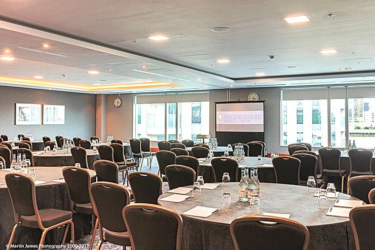 Arcadia  **Arcadia is a brilliant conference space offering natural light and stunning views of London.**  Located on the second floor of the hotel, Arcadia boasts natural daylight with views outreaching over the river Thames and the London city skyline. The Space can hold up to 220 delegates theatre style and can split into two syndicate rooms, each holding 120 delegates.  Surrounded by historic landmarks, InterContinental London – The O2 is a luxury hotel and purpose-built conference centre featuring the UK's largest pillar-free ballroom of 3,013sqm with a 7.2m ceiling height, accommodating for over 3,000 delegates. The hotel also features 19 additional versatile meeting Spaces, a full-service luxury spa and five restaurants and bars inspired by the destination's rich history.  The 3 AA Rosette and Michelin Guide, Peninsula Restaurant, offers modern European cuisine and a private dining room seating up to 24 Guests. Savour Afternoon tea in the stylish Meridian Lounge or enjoy cocktails in Eighteen Sky Bar with spectacular views of the London skyline.  The O2 arena is steps away with the Emirates Air Line zips over the Thames to ExCel London. The Thames Clipper and the Jubilee line offer fast links to London's West End and London City Airport. A complimentary hotel shuttle service operates to/from North Greenwich station daily.