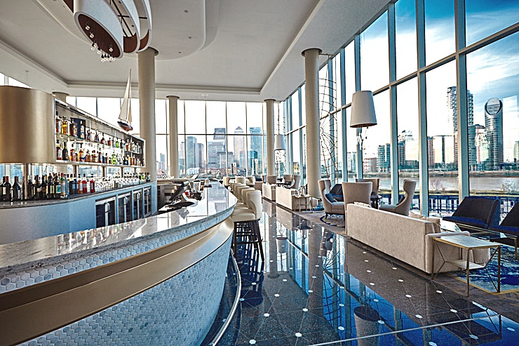 Clipper Bar  **Clipper Bar is a maritime-themed bar with spectacular views and an extensive rum and gin selection perfect for your next private party.**   A unique Space in London with 270° vista windows, capturing the amazing views of River Thames and Canary Wharf. Clipper Bar is a sophisticated and relaxing retreat where Guests can meet and unwind with delicious cocktails, local food or a unique Gin & Tonic made using our exclusive Clipper Gin. The Cliper Bar is the perfect venue for your next corporate party or after-work drinks.   Surrounded by historic landmarks, InterContinental London – The O2 is a luxury hotel and purpose-built conference centre featuring the UK's largest pillar-free ballroom of 3,013sqm with a 7.2m ceiling height, accommodating for over 3,000 delegates. The hotel also features 19 additional versatile meeting Spaces, a full-service luxury spa and five restaurants and bars inspired by the destination's rich history.  The 3 AA Rosette and Michelin Guide, Peninsula Restaurant, offers modern European cuisine and a private dining room seating up to 24 Guests. Savour Afternoon tea in the stylish Meridian Lounge or enjoy cocktails in Eighteen Sky Bar with spectacular views of the London skyline.  The O2 arena is steps away with the Emirates Air Line zips over the Thames to ExCel London. The Thames Clipper and the Jubilee line offer fast links to London's West End and London City Airport. A complimentary hotel shuttle service operates to/from North Greenwich station daily.