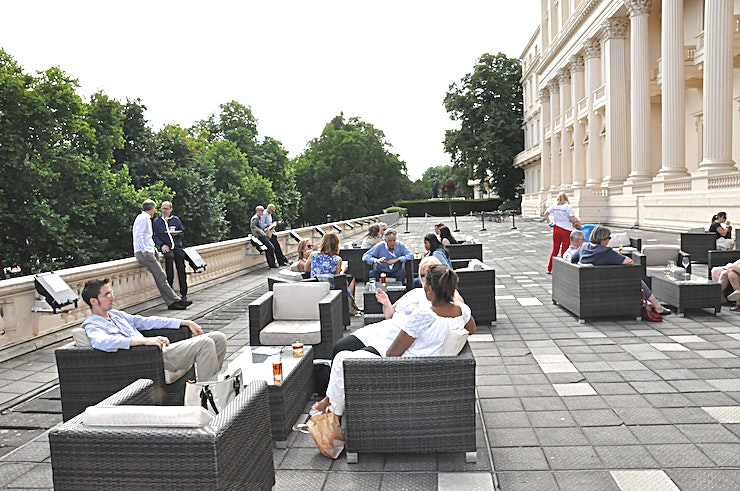 Terrace **Hire this beautiful outside Space for your summer party of drinks reception.**  Available seven days a week till 9pm, the beautiful Terrace overlooks the Mall and can hold 250 Guests.  Prince Philip House is a beautiful venue located at 3 Carlton House Terrace which has recently been restored into a beautiful and modern event Space. This historic Grade I listed building, now has a contemporary and modern interior which is the perfect Space for meetings and large corporate events. It also offer your Guests stunning views overlooking The Mall and St James's Park - in a venue to hire that is is only a short walk from Trafalgar Square.  The Rolls Royce Room room enjoys an abundance of natural light and excellent views over the Academy's entrance garden. The Space is perfectly suited for exhibitions, workshops, training, seminars and board meetings. This Space is perfect for private event venue hire with a max capacity of 75 Guests for a theatre style arrangement.