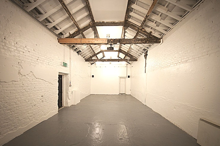 Clapton's Old Tram Depot **Book Clapton's old Tram Depot at The Depot, a versatile brickwork Space which will be a unique Hackney venue hire for your next event.**  The creative nature of the space makes it versatile for use for all kinds of events, including private parties, as a meeting venue, or as a location for a team day out.  The building - renovated horse stables and part of Clapton's 200-year-old Tram Depot - has plenty of history and character. In the past, the studios have hosted everything from pop-up restaurants, book launches, exhibitions, pop-up cinemas, parties, functions, photo and film shoots.  The studios offer flexible spaces and come equipped with a wide range of amenities, such as a projector, 4m screen, WiFi, sound system, outside space and parking, kitchen access and furniture on request.  The team at the venue are very friendly and always on hand to help out and support the activities that happen at The Depot.