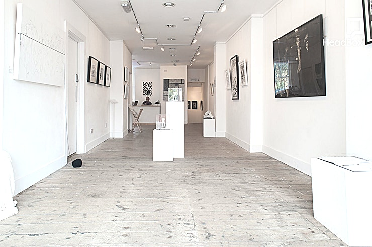 Gallery **Welcome to the Espacio Gallery for your next London venue hire - perfect for a wide range of creative events!**   Just 100m from the top of Brick Lane, Espacio Gallery comprises of two gallery floors offering a unique and inspiring environment. Both floors are bright and spacious, totalling 170sqm with high ceilings and attractive smooth white walls. The flexibility offered by the galleries make them ideal for all sorts of stimulating exhibitions. Espacio Gallery provides a unique atmosphere for exhibitions and welcomes hire for art exhibitions. The minimum hire period is one week. The gallery is also a popular filming location and has been featured on Channel 4, London Live, and more.   The ground floor gallery offers a unique venue hire that's light and airy for the perfect exhibition space. The large glass window facing Bethnal Green Road provides plenty of natural light as well as directional track lights installed on the ceiling. The lower floor gallery offers exhibitors an exciting contemporary space. Not being interrupted by natural light, the space provides an excellent environment for displaying works of a multimedia nature.  Espacio Gallery opened in 2012 and is the newest venue to hire in the heart of London's East End art scene - a co-op gallery run and funded by its own Artists Members and also by hiring the venue a few times a year to selected external artists or projects. It makes the perfect Space for creative workshops, quirky product launch venue, small networking events or training days in a venue that can accommodate up to 150 guests for a standing event.