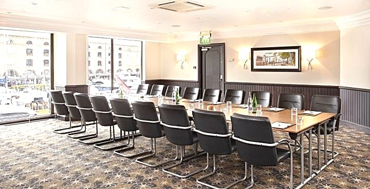 Neville Located on the upper foyer of The Tower hotel, which is dedicated entirely to meetings and events, this comfortable meeting room is suitable for up to 50 people.  Neville is ideal for presentations, training seminars and larger meetings, and with its far-reaching views over London, it's a memorable setting for any event.  The meeting room Neville is 7.7 Metres wide & 7.88 Metres long with a height of 2.5 Metres. The room can take up to 24 delegates Board room. It has natural daylight, air-conditioning and a beautiful view over St. Katharine's Docks. All of our meeting rooms have a dedicated  event host accommodating all of your event requirements. The Tower hotel offers complimentary WI-FI, pens, pads & sweets on the table as well as projector and flipchart. We can arrange tea, coffee and snacks as well as lunch if requested.  --Please note this space fee is based on a venue hire. Please message us if you need the room longer than listed and we can use bespoke pricing to accommodate this--
