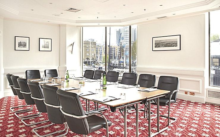 Beaufort Suite **Offering an iconic view of London's skyline sure to impress your Guests, The Tower Hotel has the London meeting room hire ideal for you**  The Beaufort Suite at The Tower Hotel is 6.05 Metres wide & 7.05 Metres long with a height of 2.74 Metres. This meeting room allows for a spacious environment for you and your Guests.  Decorated with stylish black and white photographs of London's historic landmarks, your Guests are sure to be inspired in this London meeting room hire.   The room can take up to 30 Guests in a theatre style layout, creating an event Space that can host any company occasion from team meeting to large conference.   It has natural daylight, air-conditioning and a beautiful view over St. Katharine's Docks.   All of the meeting rooms at The Tower Hotel have a dedicated event Host accommodating all of your event requirements.   The Tower hotel offers complimentary WI-FI, pens, pads & sweets on the table as well as projector and flip-chart.   With the added bonus of refreshments including tea, coffee and snacks as well as lunch if requested, this Space has everything you'll need for a successful meeting.