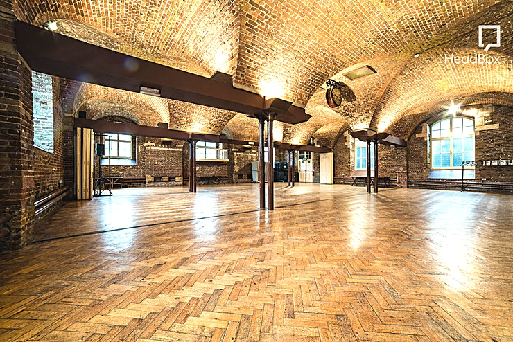 The Crypt  **Hire the Crypt On The Green is a truly unique venue hire in Farringdon.**   This brick-walled church crypt with vaulted ceiling is ideal for hosting workshops, networking events, wedding receptions, film shoots and much more.   Eight large windows make this a wonderfully airy space with plenty of natural light. The Crypt can accommodate up to 300 guests for a standing reception and seat 150 Guests for dining.
