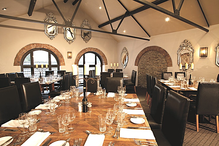 Ruinart **Book the Ruinart at Hotel du Vin & Bistro and impress your Guests with one of the top dining venues Bristol has to offer.**  Hotel Du Vin Bristol, located in the Sugar House nestled in the heart of the old city, is a delightfully restored collection of Grade II listed former sugar warehouses, lovingly transformed into one of the finest hotels in Bristol.   These wonderful specimens of 18th-century architecture come together to create charming, glowing surroundings with a boutique chic feel that makes theirs some of the area's most desirable private rooms.   Ruinart is our largest private room and benefits from high vaulted ceilings, floods of natural daylight and its own private secluded roof terrace.   Located on the second floor of the hotel accessible by both stairs and lift it can accommodate up to 34 Guests on one table, 72 Guests on 6 square tables or 60 Guests in a theatre style.  Book this Space for your next venue hire, and impress your guests with this unique party venue.