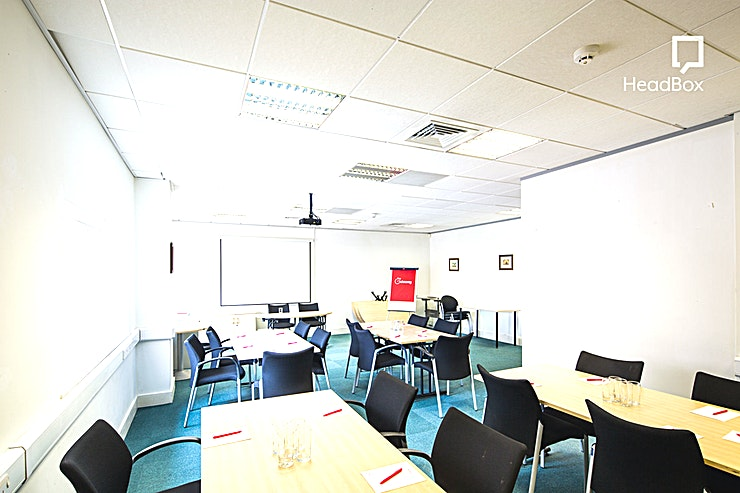 Meeting Room 5 **Meeting Room 5 at Gateway Conference Centre is the perfect meeting room hire in Liverpool**   Host a meeting, presentation, training day or workshop at Gateway Conference Centre.   The Gateway Centre was officially opened by the HRH Duke of Gloucester on the 2nd October 2002 and offers lots of great corporate Spaces.   Meeting Room 5 can accommodate up to 20 Guests for a boardroom style meeting in a room that comes fully equipped with whiteboards, flip-charts and an HD projector.   You'll have everything you'll need to host a productive meeting in this Space.  With an abundance of accessibility options, this meeting room hire in Liverpool is both effective and advanced.