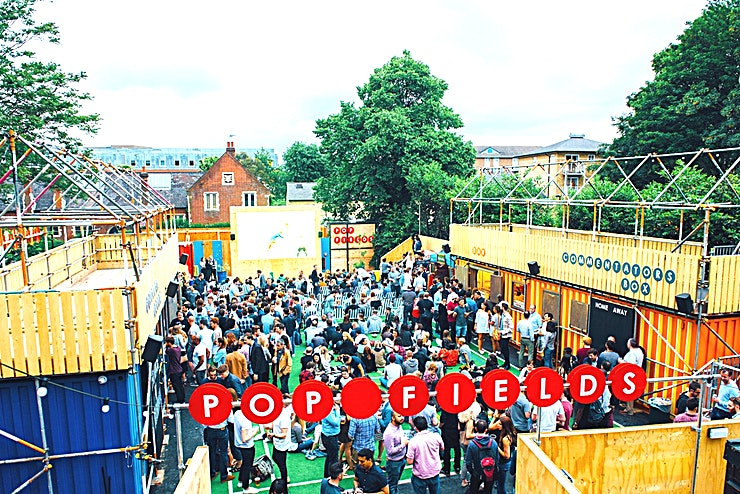 Amazing Outdoor Sports Themed Summer Party Venue Pop Fields is a 8,000 sq ft outdoor site that is perfect for hosting exciting summer events including team away days, private parties and the most unique sports days in London. It is a multi-purpose event space designed to celebrate summer, sunshine and sports.  It is part of Pop Brixton, a unique community and events space built with recycled shipping containers. The entire site is a home to 55 independent businesses including street food traders, restaurants, bars and fashion boutiques.  Pop Fields features a large 3x5m high resolutions LED Screen for watching sporting highlights, cinema screenings or any kind of exciting content.  The site is built on a multi-purpose sports pitch than can be used for any number of fun sports activities, from 4-a-side football, to sports day events or ping pong tournaments. A range of sporting equipment and activities are available on the site.  The pitch can also be transformed into an outdoor drinking, dining or dancing space, with the option of live entertainment or dining events available.  Two exclusive bars are based on the site, serving up craft beers, cocktails, Pimm's and fine wines. Catering packages can be arranged with our amazing traders including pizza from Made of Dough, Indian inspired street food from Baba G's, Basque tapas from Donostia Social Club and much, much more...