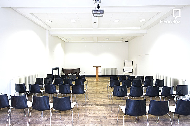 Sandon Room **Hire the Sandon Room at Bluecoat foran ideal venue hire in Liverpool for your next conference, meeting or creative workshop.**  Located off the garden on the ground floor with restored windows, doorways and fireplaces, this light and airy space can be hired on its own or with The Garden Room to allow for breakout spaces.  These spaces are also perfect for drinks receptions and seated dinner parties in one of the most versatile Liverpool venue hires around!   Space Specifications:  *Reception for 60 *Dinner for 40 *Meeting or conference for 50
