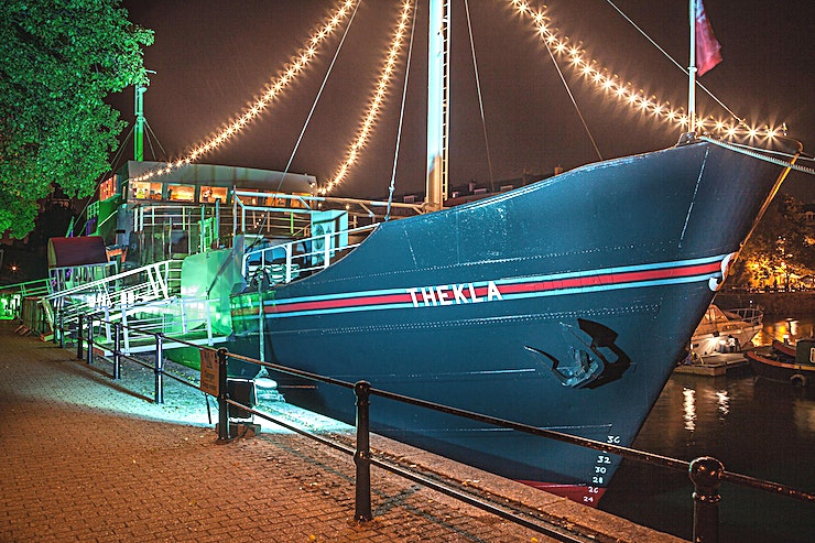 Venue Hire **Exclusively hire The Thekla for your next event with a VIP edge.**  Thekla is a former cargo ship in Bristol's Floating Harbour. The ship was built back in 1958 and has a 600 guest capacity. This