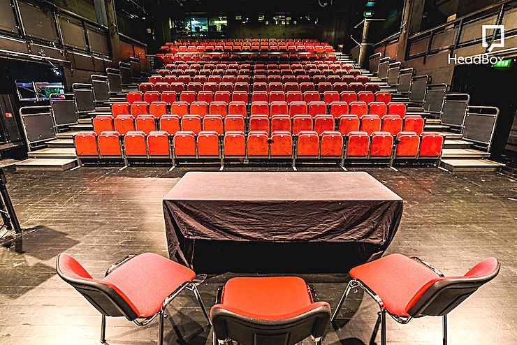 Auditorium **Hire the Auditorium at the Arnolfini - the centre of contemporary arts in Bristol for a unique venue hire in Bristol.**  Arnolfini is a unique venue hire with an enviable position on Bristol's Harbourside, yet close to the city centre. Incorporating art galleries, performance / music/ cinema venue, bookshop and café bar, Arnolfini is a dynamic and versatile location suitable for a variety of events.   We offer flexibly priced packages for fully catered events, professional sound, lighting, projection and presentation facilities and box office support to help ensure your event is a success. Incorporating a large cinema-quality screen and projection facilities, this space is ideal for conferences, large screenings and seminars.