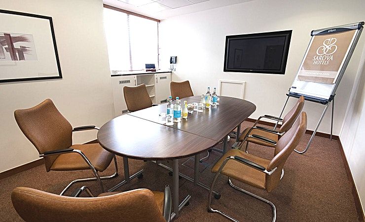 Sandringham Boardroom The ideal location for intimate boardroom meetings and breakout sessions for up to six delegates. The room features complimentary WiFi, air conditioning, built in plasma screen, still and sparkling water, stationery, telephone, sweets and confectionery, access to breakout area, contemporary lighting and flexible seating arrangements.  **All rooms feature:** • Complimentary WiFi • Natural daylight • Air conditioning • Built in plasma screen • Flipchart • Stationery • Still and sparkling water • Tea, coffee and refreshments • Sweets and confectionery • Access to breakout area • Telephone • Contemporary lighting • Flexible seating arrangements