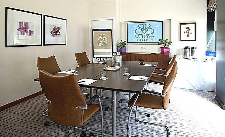 Highgrove Boardroom Floor-to-ceiling frosted windows make this a light, airy and private venue for boardroom meetings for up to 10 people.