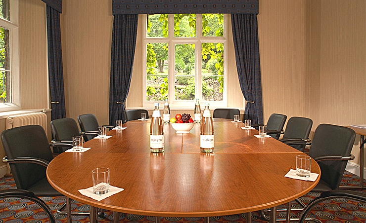 Malvern Suite Overlooking the Malvern Hills, this light-filled room is located on the first floor and is suitable for boardroom meetings for up to 14 or seminars for up to 20.  **Malvern Suite amenities:** • Natural daylight • Black out curtains • Built-in screen • Free WiFi • Coat stand • Flexible seating arrangements • Direct dial telephone • Disabled access