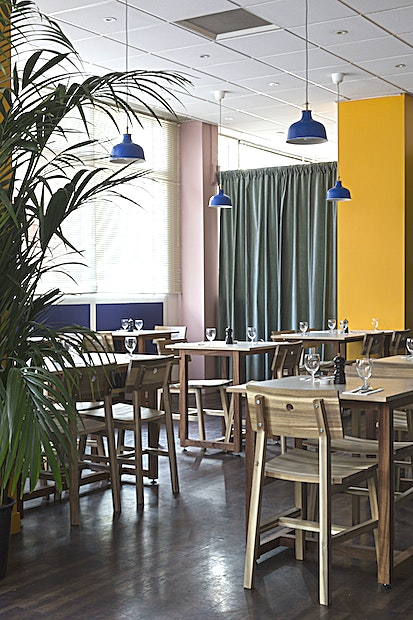 Quilombero - canteen and bar  Quilombero is a pop-up restaurant, canteen and bar situated in East India Dock within an old Costa Coffee. We have a beautiful, light filled ground floor space that opens out onto a little lake with an outside terrace and garden. Within our development we have various spaces suited for meetings, private dining, special lunches and dinners.