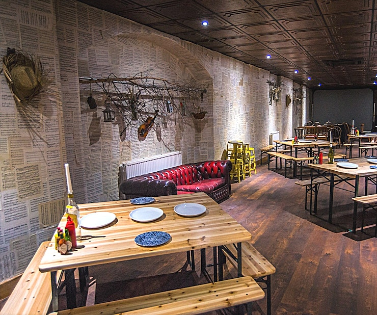 Below Boondocks **Below Boondocks is our secret weapon based conveniently below Boondocks restaurant in Old Street, London.**  The unique Southern American inspired setting boasts a 150 person capacity, perfect for Birthdays, Live Entertainment, Workshops, Private Film Screenings/Cinema Clubs, or Corporate Events.   Bespoke menu options and a stage area with sound and lighting make Below Boondocks a flexible and unique option for any event.