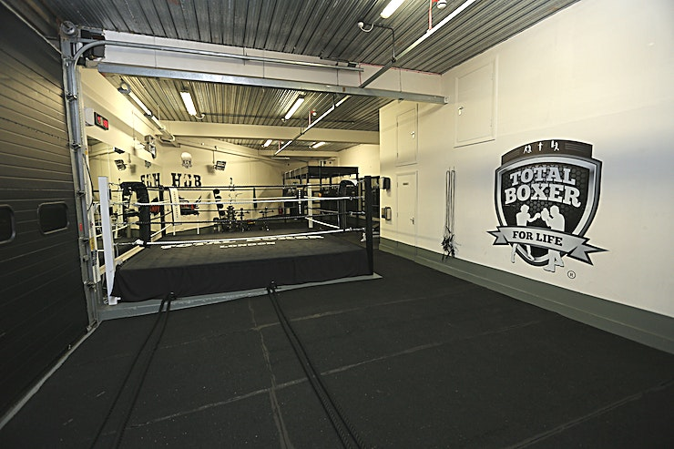 Boxing Gym and meeting rooms If you're looking to hire a unique location hire in North London for a production or event look no further than Total Boxer®.  When we're not busy delivering kick-ass training, our awesome two floor club near Crouch End in North London is available to hire for a range of personal and corporate use purposes; from photo and video shoots to rehearsals and product launches.   Our 3000 sqft boxing and fitness facility includes outdoor space, separate male/female toilets and showers, changing rooms, kitchen, green room, boardroom and ample on-site parking. Hire is available by floor or the entire space, subject to timing and availability.  The space is truly flexible and we're open to ideas, please get in touch to discuss your requirements!