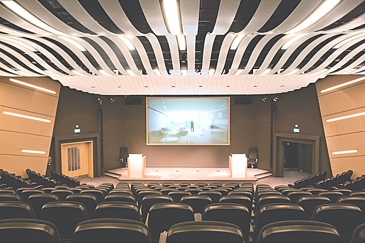 The Nucleus Auditiorium Featuring tiered seating and a generous stage for debates or lectures, the Nucleus Auditorium holds up to 233 people. Perfect for high profile events, the space comes with a full complement of audio-v