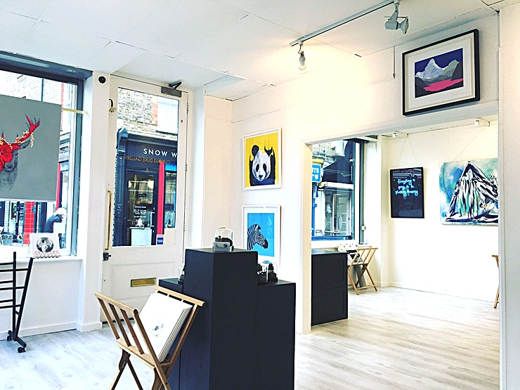 Curious Duke Gallery **Exclusively hire the Curious Duke Gallery for a creative venue hire that'll make sure your event is one of a kind.**   The Curious Duke Gallery is perfectly located in the bustling Whitecross Street in East London. The gallery comprises of two spaces that are opened up by a large archway. We are located on the corner of the street with windows all the way around which really maximizes the space and creates great lighting. The gallery is approximately 7 Meters by 6 Meters, the gallery will always have different works of art up on the walls and have a couple of plan chests that cannot be moved. We are open to renting the space out during mornings, evenings, and weekends.  Curious Duke Gallery started in September 2011 as a pop up, in addition to the online gallery, in the urban and contemporary art hub of East London. This unique venue hire can accommodate up to 70 guests for a standing reception so is perfect for product launches, workshops or networking events with a creative and quirky backdrop.