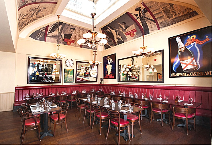 Private Dining Room **Want private dining in Edinburgh that will really impress? Welcome to the Private Dining Room at Cafe Rouge Edinburgh!**  Located on the historic cobblestone Frederick Street, Cafe Rouge Edinburgh restaurant offers a stunning interior and large outside dining terrace, perfect for enjoying a glass of wine in summer.  The Private Dining Room at Cafe Rouge Edinburgh is a bright airy room thanks to a large window and ornate glass ceiling.   This Edinburgh Private Dining Room is decorated with grand mirrors and the walls are adorned with vintage French prints. The space has banquette seating which runs around two sides of the space perfect for either private dining set up for 60 people or for standing events for up to 80.