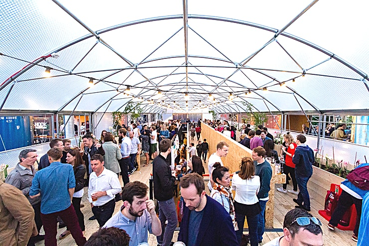 The Greenhouse **The Greenhouse at Pop Brixton is the perfect party venue to hire in south London.**  The Greenhouse is located at the very centre of Pop Brixton, overlooking the main square and street food aisles via its retractable windows and sliding doors.   This large covered polytunnel benefits from plenty of natural light and planting, providing a picturesque location for entertaining.   The Greenhouse is available for standalone hire or in conjunction with Pop Box for networking events, exhibitions, drink receptions and film and photography shoots.   Please be aware, that the prices quoted are only basic and we can provide bespoke packages to suit you.