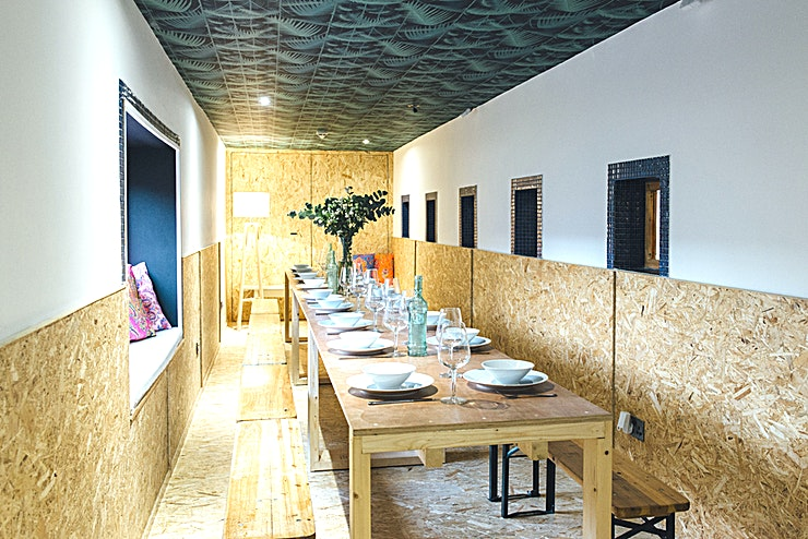 """The Dining Room **Book The Dining Room at The Pop Brixton.**  Please be aware that these prices are very basic and can change dependant on your requirements  The Dining Room, Pop Brixton's smallest venue space is conveniently tucked away on the first floor of our main venue space. Next door to The Kitchen and with windows overlooking Pop Box, The Dining Room is not only an intimate standalone hire space, but a handy add on for clients using Pop Box or The Kitchen.   Most commonly used for business meetings, training programs or private dining, this is the space for you! The Dining Room, is equipped with a 32"""" HD Television, refrigerator and boardroom table."""