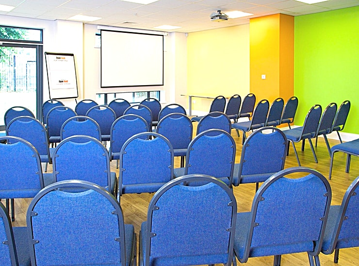 Muller Room **Hire the Muller Room at the LifeCentre for your next meeting room hire in Manchester.**   A medium sized room which accommodates up to 32 cabaret style, 20 boardroom or 45 theatre. On the ground floor for easy access and close to the on-site cafe. Free on-site parking and superfast wi-fi is included for all our rooms.  No extra charge for Flipcharts or the ceiling mounted projector. The LifeCentre has some of the best meeting rooms Manchester has to offer.
