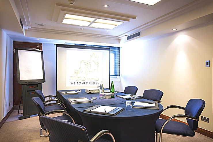 Tyger Suite **Looking for an intimate meeting room hire between Wapping and the City of London? The Tyger Suite at the Tower Hotel is for you**  This London meeting room hire can facilitate up to 8 Guests in a boardroom style layout.   This Suite boasts a brilliant option for interviews, presentations and out of office meetings.  Alternatively, utilise this Space for meetings with corporate clients and international Guests, as Tower Bridge tube station and London Fenchurch Street train station are both close by.  This meeting room hire presents a modern Space with an abundance of natural daylight, air-conditioning and a beautiful view over the River Thames.   Also providing a dedicated event Host accommodating all of your event requirements and complimentary WI-FI, pens, pads & sweets on the table as well as projector and flip-chart.   You won't want for anything in this efficient and well accommodating London meeting room hire.