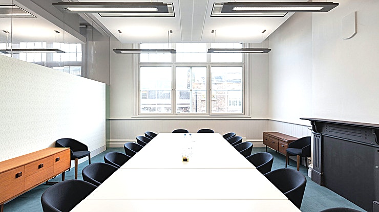 Meeting Room 7 **Book the Meeting Room 7 at The Office Group Eastside for your next London meeting room hire.**  The Office Group are the proud owners of the Eastside Office situated in King's Cross - in one of the most iconic Grade 1 listing venues that was designed in 1852. The Office Group have taken two floors of offices that form part of the main station building. Enter from the front of station on the corner of York Way and Euston Road, just to the right of the beautiful arches looming over the main entrance. The offices have been comprehensively refurbished revealing the original brickwork and steel and iron features of the building. Alongside private office space, it's got a shared work space & co-working lounge as well as a range of meeting rooms, event space and dining spaces throughout the first floor. So if you're on the look out for venues for hire, book one of the top meeting rooms London has to offer!