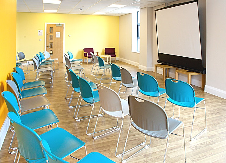 Luther King Room A medium sized room which accommodates up to 24 cabaret style, 16 boardroom or 35 theatre. On the first floor overlooking the front of the bulding. Free on-site parking and superfast wi-fi is included