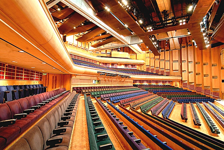 Barbican Hall **Hire the Barbican Hall at the iconic Barbican for one of the best venues to hire London has to offer. This large Space is ideal for conferences, workshops and screenings.**  With its superb technical resources, intelligent design and excellent acoustics, Barbican Hall is justifiably acknowledged as one of the country's finest auditoriums. Its breadth of facilities and size, seating from 500 to 1943 people, make the Hall the ultimate venue for larger conferences.   The Hall offers an intimate, yet persuasive, atmosphere with excellent sight lines, tiered seating and air conditioning ensuring comfort whilst keeping audiences involved and alert. Its flexible configuration makes the Hall ideal for corporate conferences, AGM's and product launches.