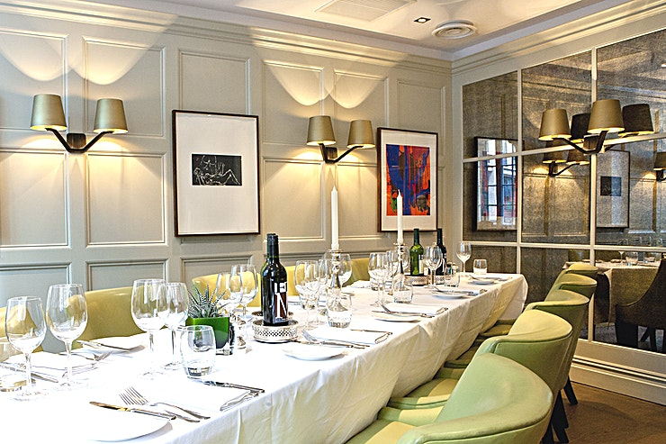 Grub Street **Hire the Grub Street Space at Chiswell Street Dining Rooms for your next private venue hire in London.**   Chiswell Street Dining Rooms is just a stones throw away from the Barbican centre and is one of London's top restaurants. Our intimate private room is named after the street which is now called Milton Street and features Georgian panelled walls, vintage distressed mirrors, artwork by Tracey Emin and handcrafted oak flooring.   It provides a classic setting perfect for private dining or a private standing reception. Grubb Street can accommodate up to 14 people for dinner or 20 people for a standing reception in this unique London venue hire.
