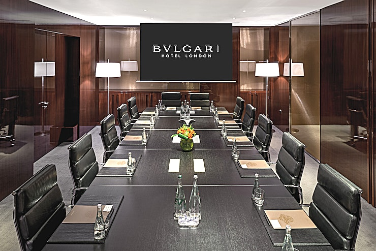 """Lord Marshall  Boardroom 1&2 **Hire the Lord Marshall Boardrooms at the Bulgari Hotel for your next London meeting room hire.**  Bulgari Hotel London's two stand-alone boardrooms, dedicated to Lord Marshall of Knightsbridge can cater for up to 16 guests when they are combined. The Boardrooms benefit from adjacent lounge with Sapele mahogany walls and a curated library of business, classics and design books which can be used as coffee breakout and casual working lunch space.  The boardrooms feature the latest technology including high definition widescreen data projector and screen, additional 46"""" Loewe High Definition LCD screens, connections for computer and other video sources, high definition video conferencing suite and complimentary wireless internet so you'll have everything you need to make sure your next corporate event runs as smoothly as possible in this fully equipped London venue hire."""