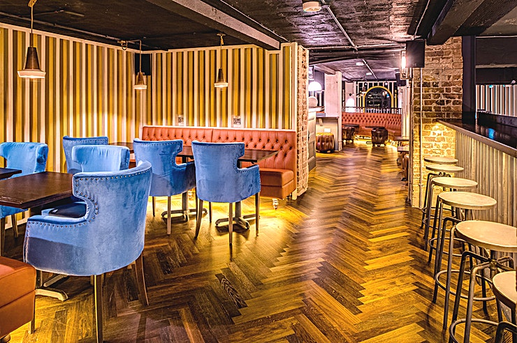 The Upper Clubhouse Hire the Upper Clubhouse at Swingers for the perfect choice for your next private party venue hire in London.   The Upper Clubhouse and bar is a blend of booth and banquette seating. It looks out ov