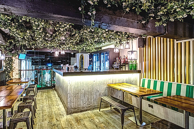 The Upper Club House and Gin Terrace The Upper Club House and Gin Terrace can be combined for larger parties of up to 150 people.  The Upper Clubhouse and bar is a blend of booth and banquette seating. It looks out over the Windmill an