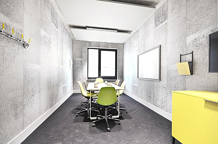 """Screening Room One **Need a great option for screening room hire in North London? Welcome to the Workspace ScreenWorks centre.**   Our 6 seater meeting room features a 43"""""""" LED screen, high-speed Wi-Fi and a writeable wall and, for the design-concious, mechanical wall features and faux-stone walls and flooring give Screening Room One a trendy, industrial feeling.  Teas and coffees can be provided by the award-winning on-site cafe, upon request."""